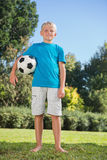 Young blonde boy holding football Stock Images