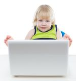 Young blonde boy looking at computer screen Royalty Free Stock Photography