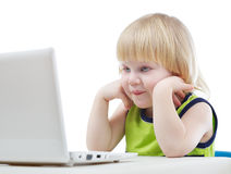 Young blonde boy looking at computer screen Royalty Free Stock Photos