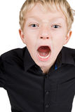 Young Blonde Boy Shoting into the Camera Royalty Free Stock Photo