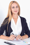 Young blonde business woman with laptop in the office.  Stock Photo