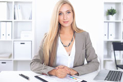 Young blonde business woman with laptop in the office.  Royalty Free Stock Photography