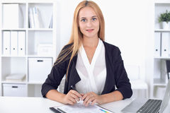 Young blonde business woman with laptop in the office.  Stock Images