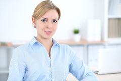 Young blonde business woman with laptop in the office. Business concept.  Royalty Free Stock Photo
