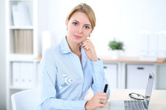 Young blonde business woman with laptop in the office. Business concept.  Royalty Free Stock Images