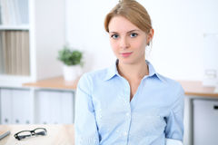 Young blonde business woman with laptop in the office. Business concept.  Royalty Free Stock Photos
