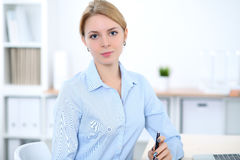 Young blonde business woman with laptop in the office. Business concept.  Royalty Free Stock Image