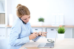 Young blonde business woman with laptop in the office. Business concept.  Stock Images
