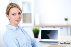 Young blonde business woman with laptop in the office. Business concept. Young blonde business woman with laptop in the office. Business concept Stock Photos