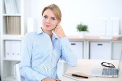 Young blonde business woman with laptop in the office. Business concept.  Royalty Free Stock Photography