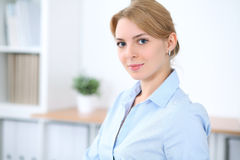 Young blonde business woman with laptop in the office. Business concept.  Stock Photos
