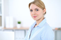 Young blonde business woman with laptop in the office. Business concept Stock Image