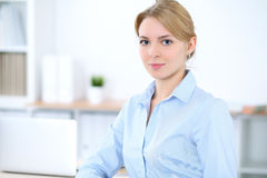 Young blonde business woman with laptop in the office. Business concept Royalty Free Stock Photography