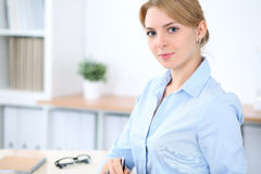 Young blonde business woman with laptop in the office. Business concept Stock Photos