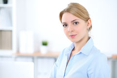 Young blonde business woman with laptop in the office. Business concept Royalty Free Stock Photo