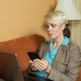 Young attractive businesswoan working in a hotel Stock Image