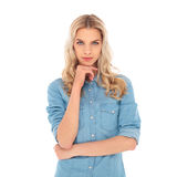 Young blonde casual woman thinking Royalty Free Stock Images