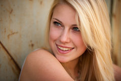 Young blonde caucasian girl alone on a street Royalty Free Stock Photo