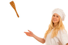 Young blonde chef points to copy space as she presents a new rec Royalty Free Stock Image