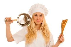 Young blonde chef woamn holds kitchenware as she prepares to coo. K a meal isolated over white background royalty free stock images