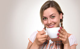 Young blonde with a cup Royalty Free Stock Photos