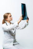 Young blonde doctor with x-ray sitting Royalty Free Stock Image