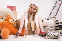 Young blonde dressed up as a doll Royalty Free Stock Photography