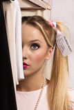 Young blonde dressed up as a doll Stock Photography