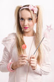 Young blonde dressed up as a doll Stock Photo
