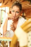 Young Blonde Drinks Out Of A Mug Royalty Free Stock Image