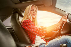 Young blonde drive a car Royalty Free Stock Photography