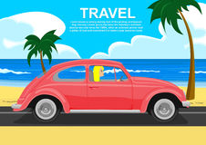 Young blonde driving retro car along the sea coast Stock Photography