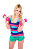 Young blonde with dumbbells isolated on white Stock Photo