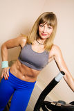 Young blonde exercising on stepper equipment. Beautiful young blonde exercising on stepper equipment Stock Photography