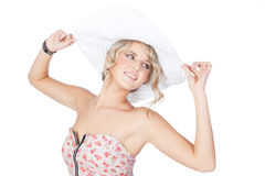 Young blonde fashion woman in a big hat in studio Royalty Free Stock Image