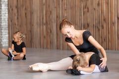 Woman teach ballet girls Stock Images