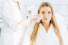 Blonde woman undergoes a procedure of facial gas-liquid oxygen peeling. Young blonde female beauty getting effective removal treatment on her skin, such as stock images