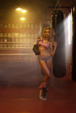 Young blonde female boxer with gloves Royalty Free Stock Photos