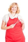 Young blonde female chef cook Royalty Free Stock Image