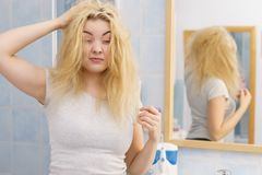 Woman feeling tired in bathroom royalty free stock photo