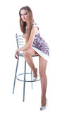 Young blonde female on the stool Stock Photos