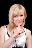 The young blonde with a finger at lips Royalty Free Stock Photos