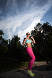 Young Blonde fit Athletic woman exercising. In Central Park Royalty Free Stock Images