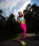 Young Blonde fit Athletic woman exercising Stock Images