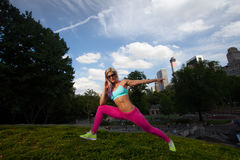 Young Blonde fit Athletic woman exercising in Park. Young Blonde fit Athletic woman exercising in Central Park Stock Image