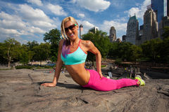 Young Blonde fit Athletic woman exercising in Park. Young Blonde fit Athletic woman exercising in Central Park Stock Photography