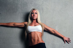 Young blonde fitness woman Royalty Free Stock Image