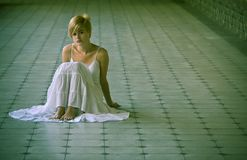 Young blonde on the floor Stock Image