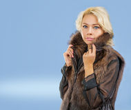 A young blonde in fur coat Stock Photo