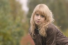 Young blonde girl. A beautiful young blonde girl royalty free stock photography
